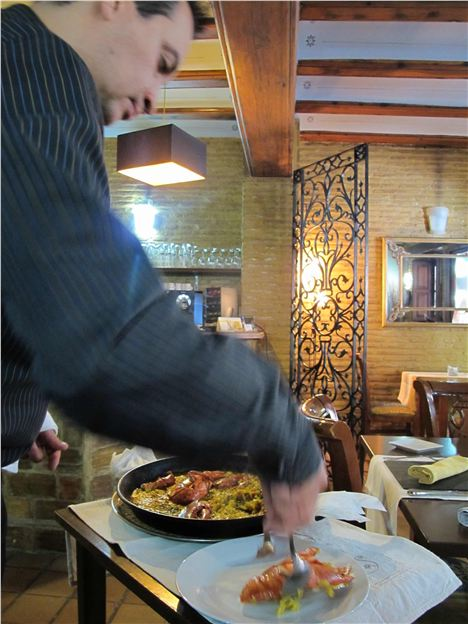 Serving Paella In Chust Godoy
