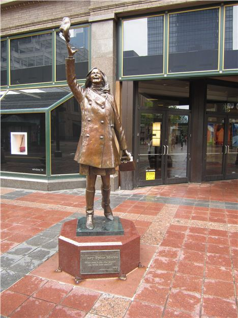 An Exuberant Statue Dedicated To The Actress Mary Tyler, Moore Stands Outside Macy's. She Starred In A Seventies Sitcom Set In The City Department Store