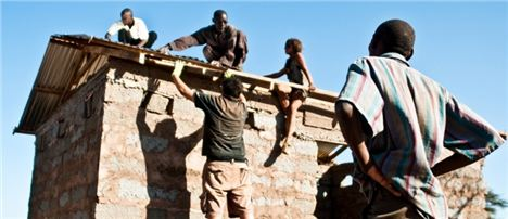 7 Ke-Life On The Project 1 Pr180 Hgm231 221 - Volunteers Constructing The Posho Mill, Turns Maize Into Maize Flour