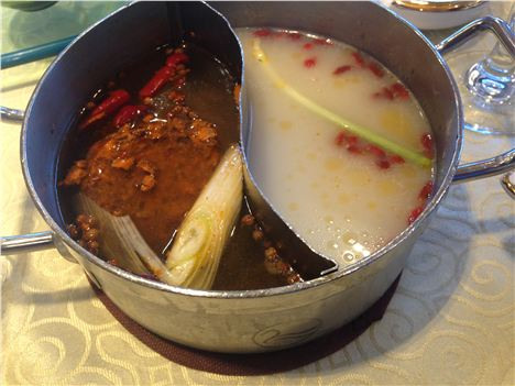 The hotpot bubbling away, spicy on the left the way the locals like it, mild on the right