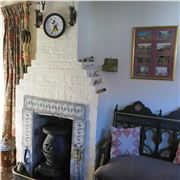 The Cottage's Cosy Fireplace