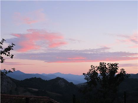 Sunset over the mountains from the terrace at Casa Marcial