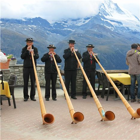 Blowing Their Alpine Horns At The Hotel Reached By The New Sunnegga Funicular
