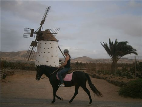 Fuertoventura Riding On Apache Past Windmill